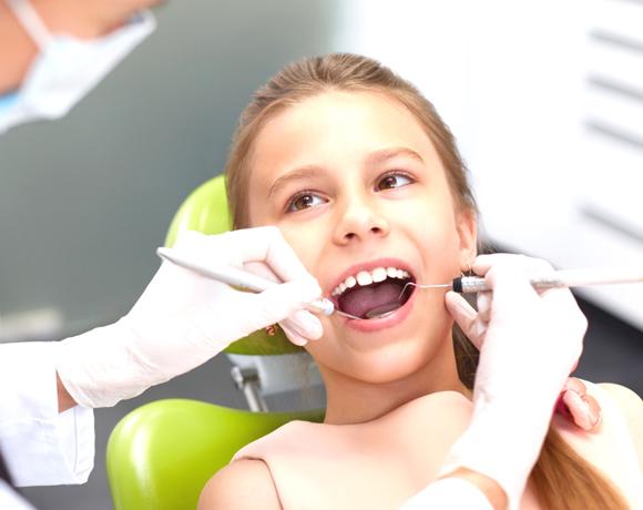 Удаление молочного зуба у ребенка. Стоимость для детей в Киеве